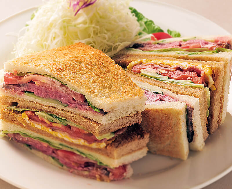 Clubhouse sandwiches with salad Image