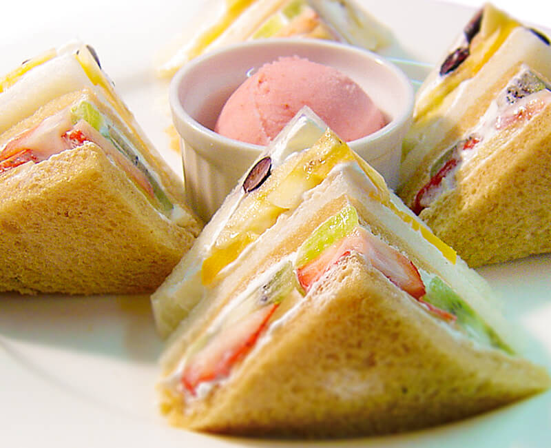 Fruit sandwiches with salad or ice cream Image